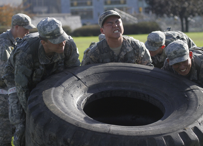 Cadets lifting tractor tire